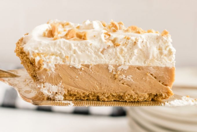 slice of no bake peanut butter pie on a pie server