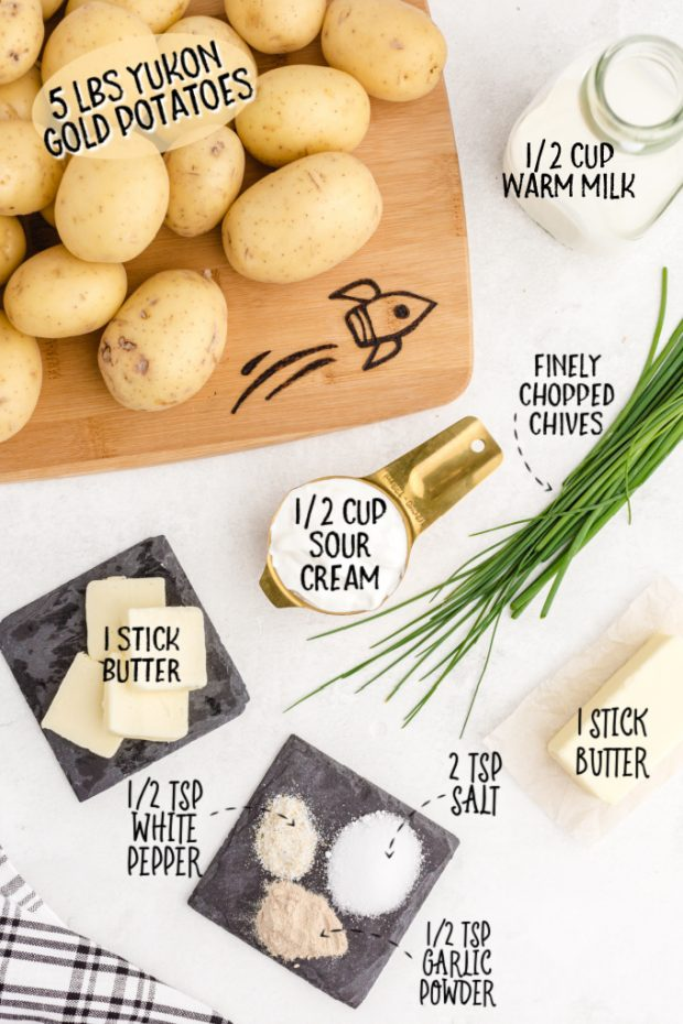 ingredients for mashed potatoes on a white surface taken overhead