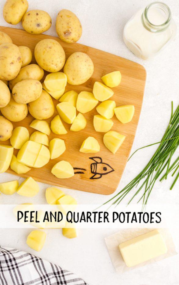 raw potatoes cut into quarters on a wood chopping board