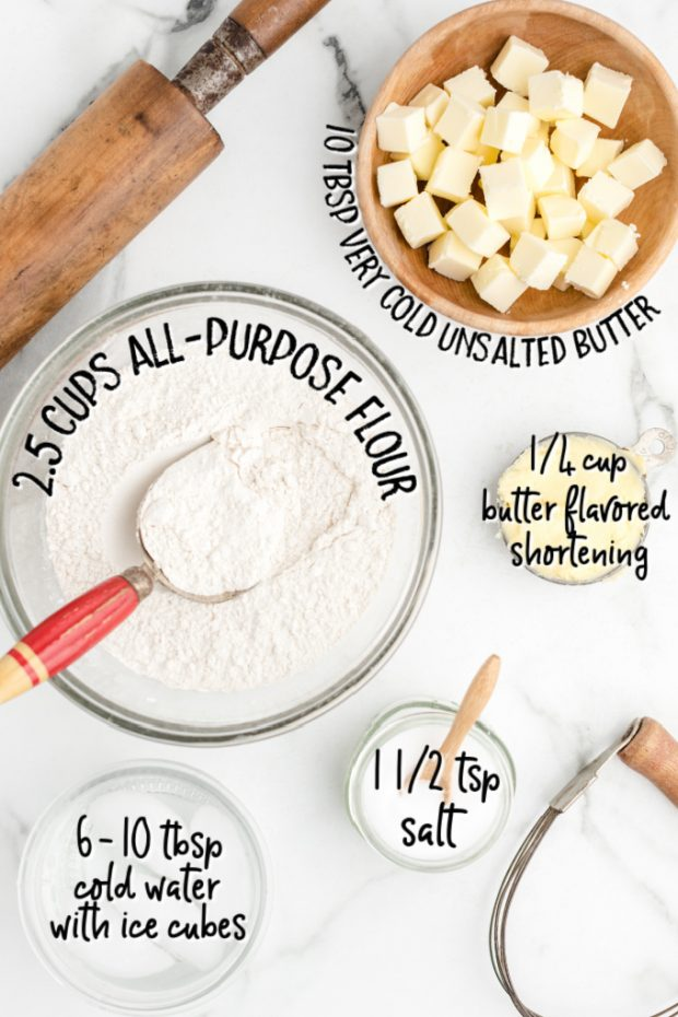 ingredients for pie crust overhead shot on white marble