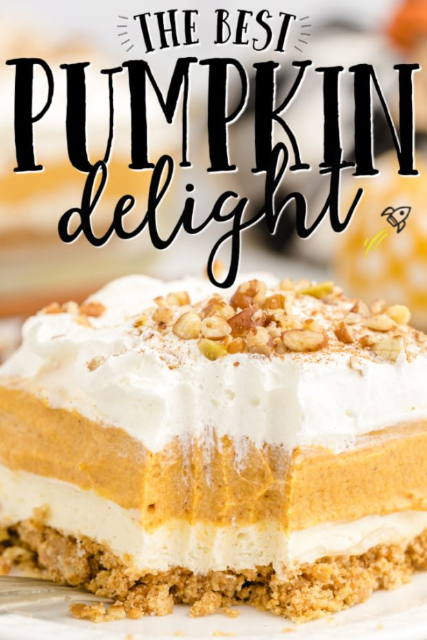 A piece of cake on a plate, with Cream and Pumpkin delight