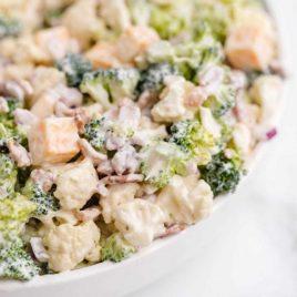 close up shot of a bowl of broccoli cauliflower salad