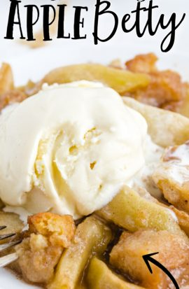 close up shot of grandma's apple betty with a scoop of ice cream on top served over a white plate