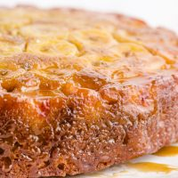 close up shot of banana upside down cake served on a white tray