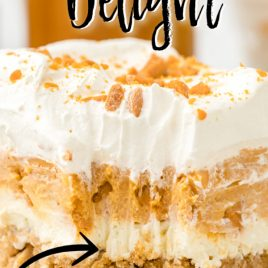 close up of a slice of butterscotch delight with a bite taken out