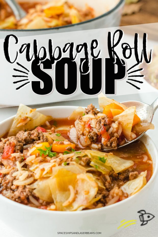 cabbage roll soup in a bowl with a spoon about to take a bite and with text overlay