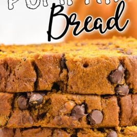 close up shot of chocolate chip pumpkin bread slices stacked on top of each other on a wooden board