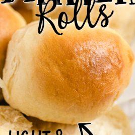 close up shot of dinner rolls in a black basket