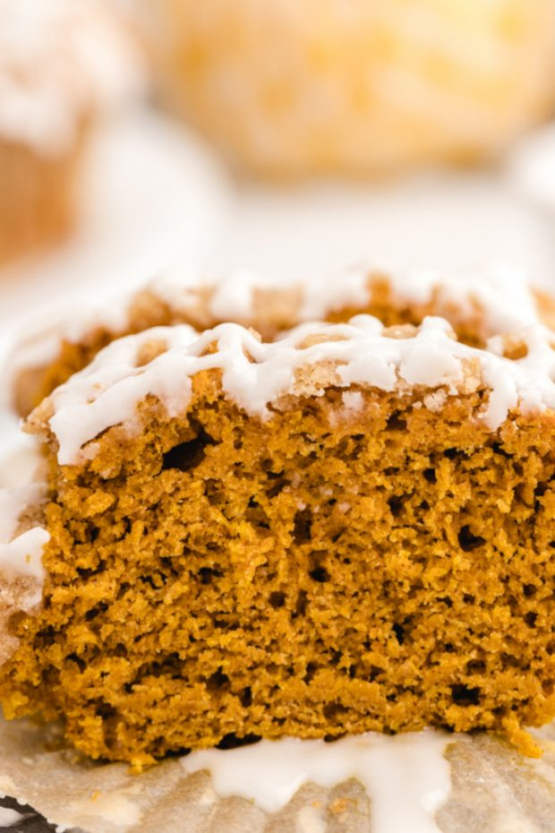 pumpkin spice muffin cut in half with a close up of the cross section