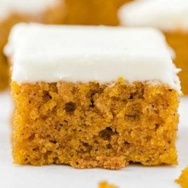 close up shot of pumpkin bars topped with cream cheese frosting