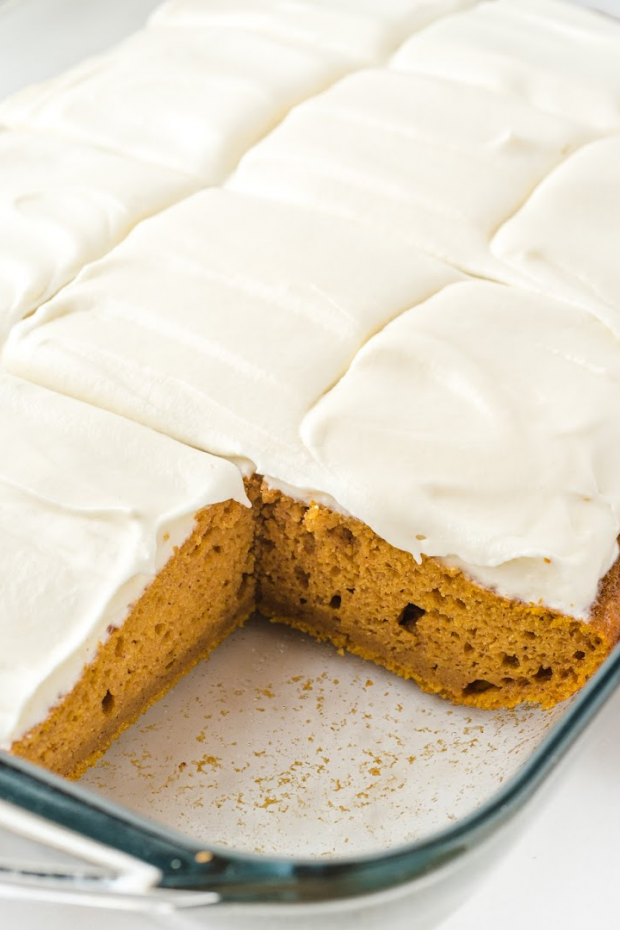 pumpkin bars with cream cheese frosting in a clear baking pan