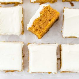 close up overhead shot of pumpkin bars topped with cream cheese frosting