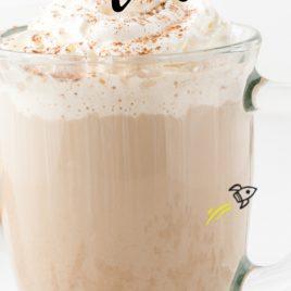 homemade pumpkin spice latte close up in a glass mug