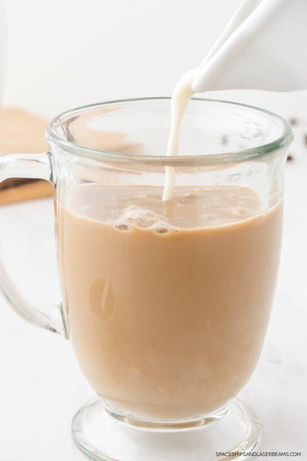 homemade pumpkin spice latte being prepared with milk