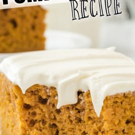 pumpkin bars slice with cream cheese frosting on a white dish