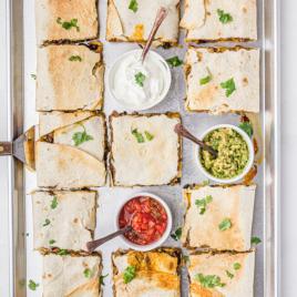 sheet pan quesadillas with sauces on a pan