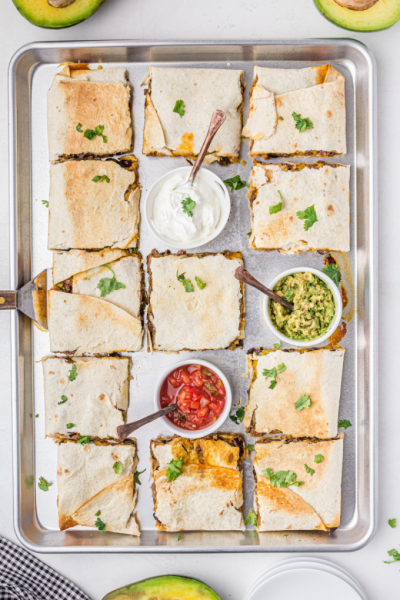 sheet pan quesadillas with sauces on a pan