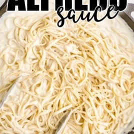 copycat olive garden alfredo sauce topped over pasta in a pot