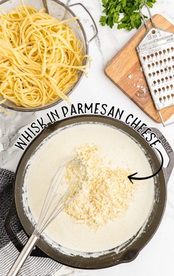 copycat olive garden alfredo sauce process shot of whisking parmesan cheese into alfredo sauce mixture