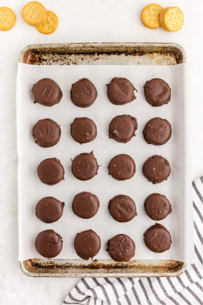 Chocolate Peanut Butter Ritz Cookies on a pan with a white background