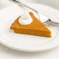 crustless pumpkin pie on a white plate with a fork