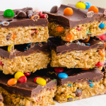 close up shot of no bake monster cookies stacked on top of eachother
