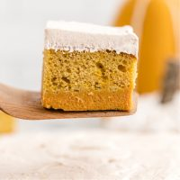 pumpkin magic cake on a cake server showing three distinct layers