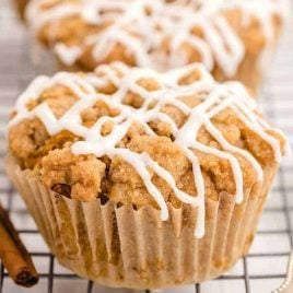 close up overhead shot of Pumpkin Spice Muffins drizzled with icing on a cooling rack