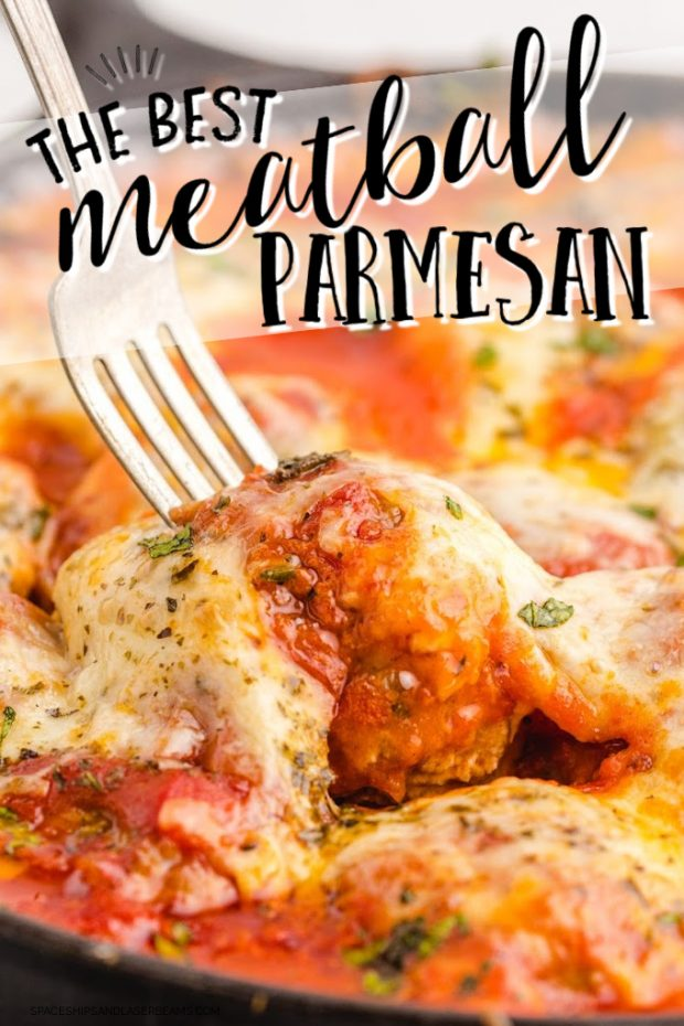 close up shot of meatball parmesan with parmesan cheese and pasta sauce on a fork