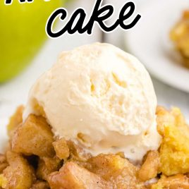 close up shot of a serving of apple dump cake topped with vanilla ice cream on a plate