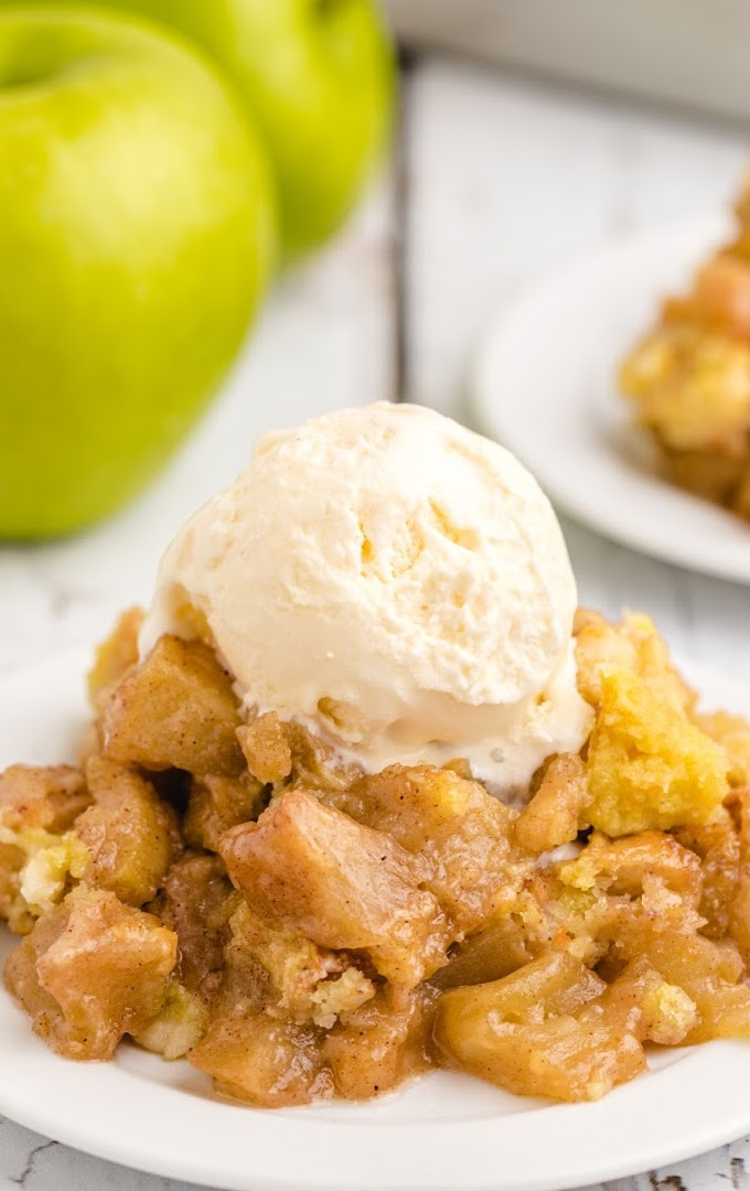 close up shot of apple dump cake with ice cream on top