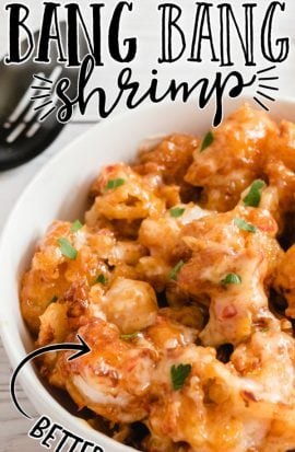 close up shot of bang bang shrimp with sauce poured on top