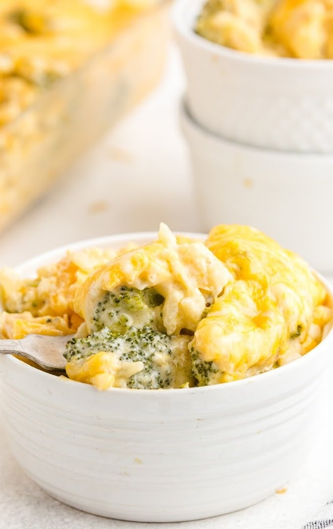 close up shot of broccoli and rice casserole in a white bowl