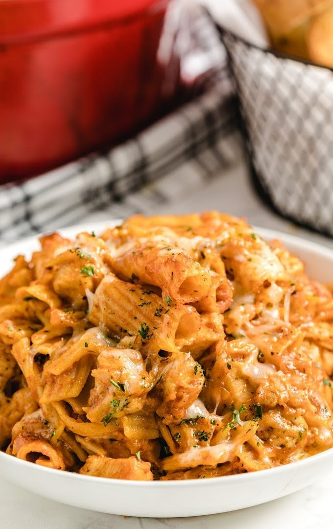 one pot chicken parmesan pasta in a white bowl