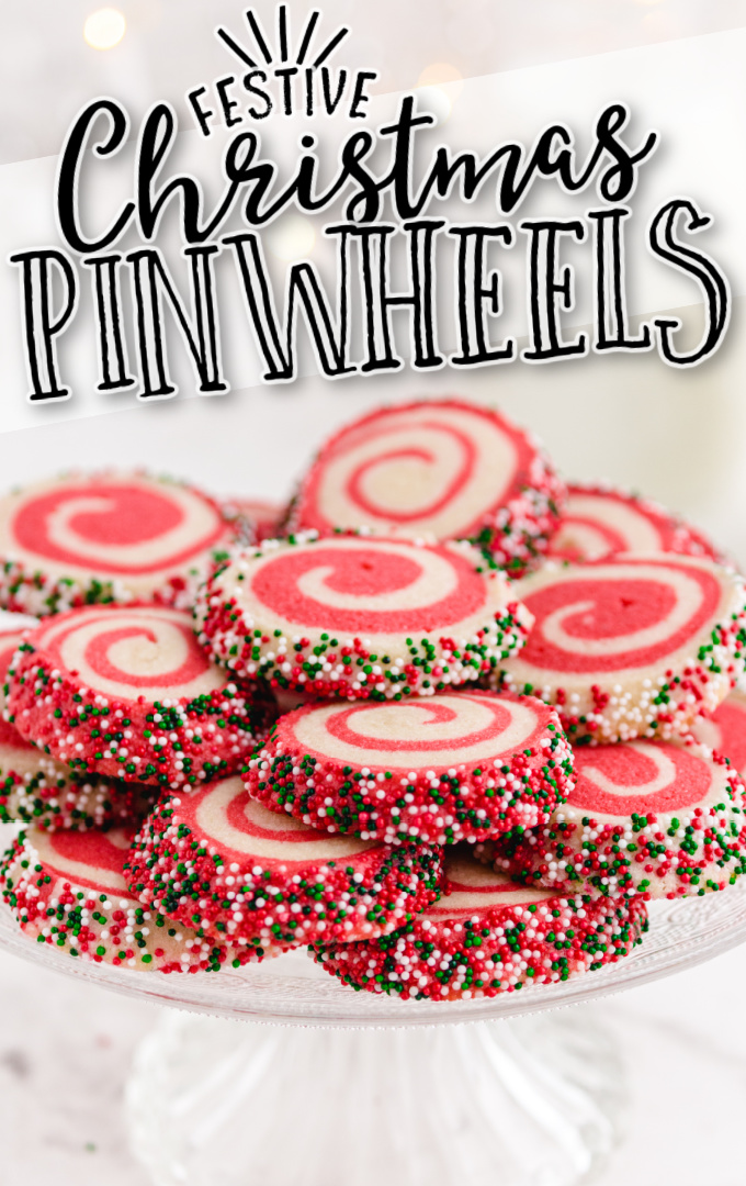 christmas pinwheels cookies stacked on top of each other on a cake tray