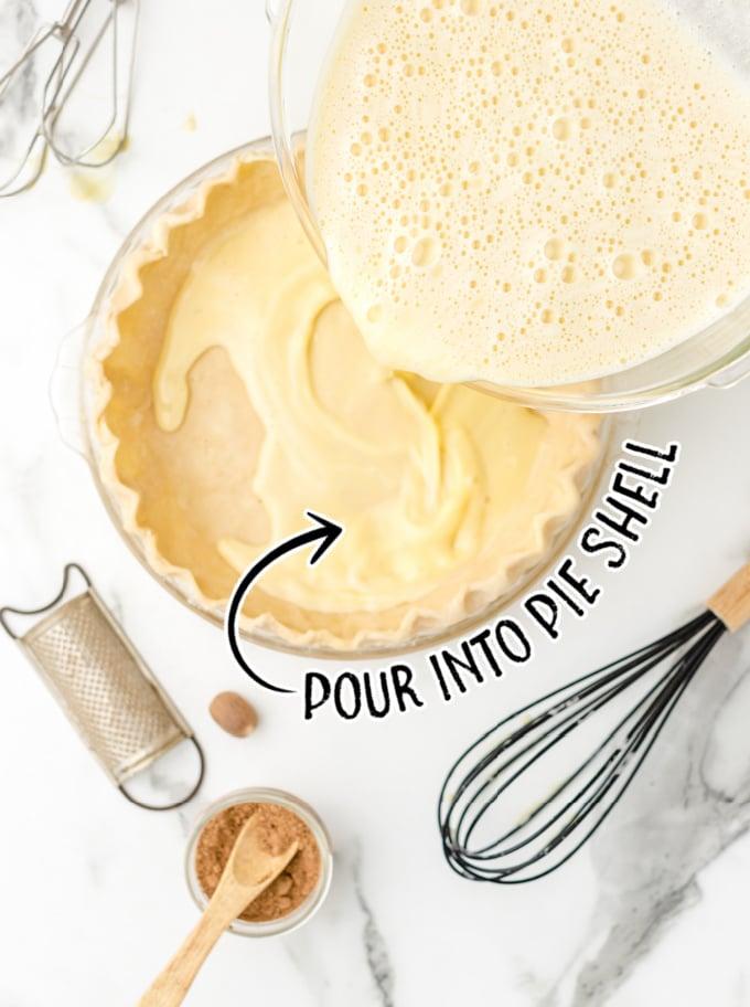 custard pie process shot of pie mixture being poured into pie shell