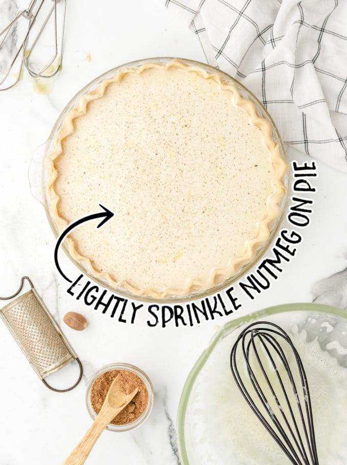 custard pie process shot of pie being sprinkled with nutmeg