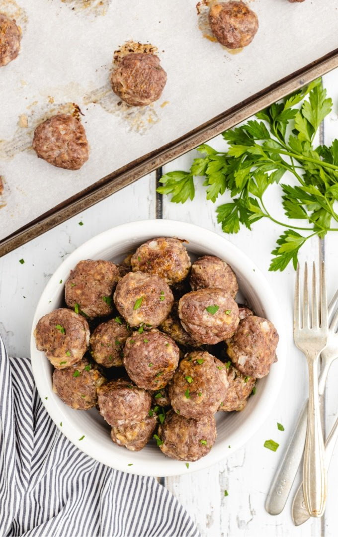 overhead shot of homemade meatballs in a white bowl