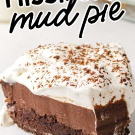 close up shot of a slice of Mississippi Mud Pie garnished with chocolate shavings on a plate