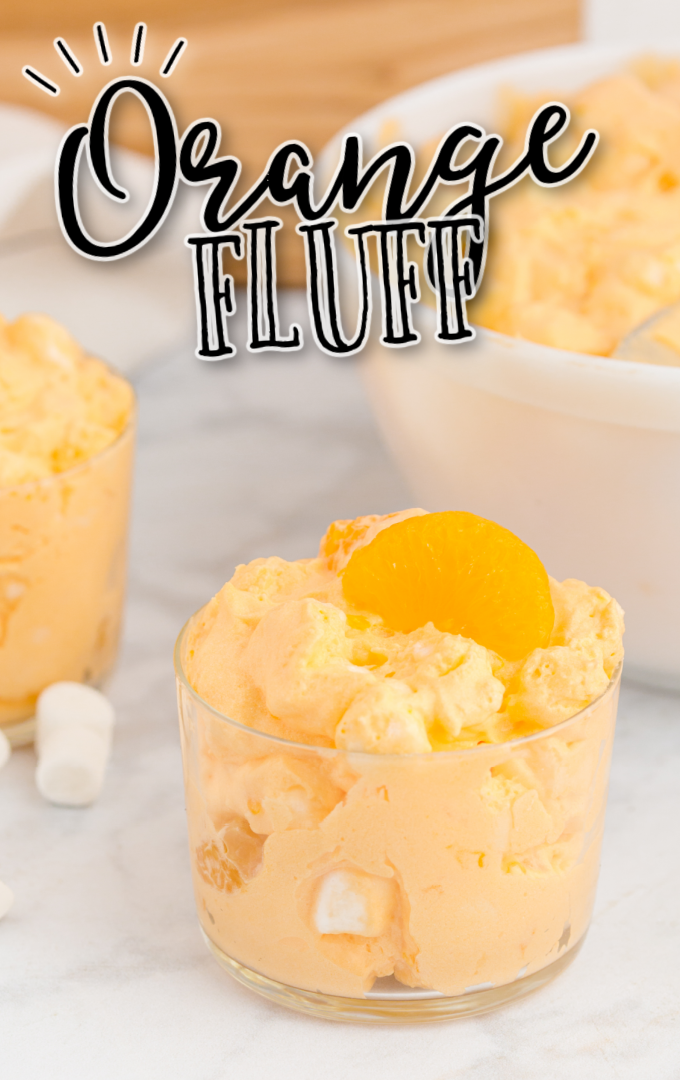 orange fluff in a clear cup with marshmallows and mandarin oranged