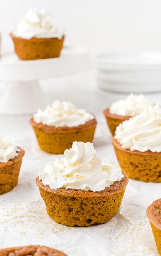 impossible pumpkin pie cupcakes with whipped cream on the top
