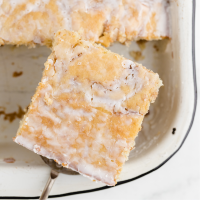 close up shot of cinnamon roll cake slice being picked up with a spatula
