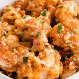 bang bang shrimp garnished in a bowl