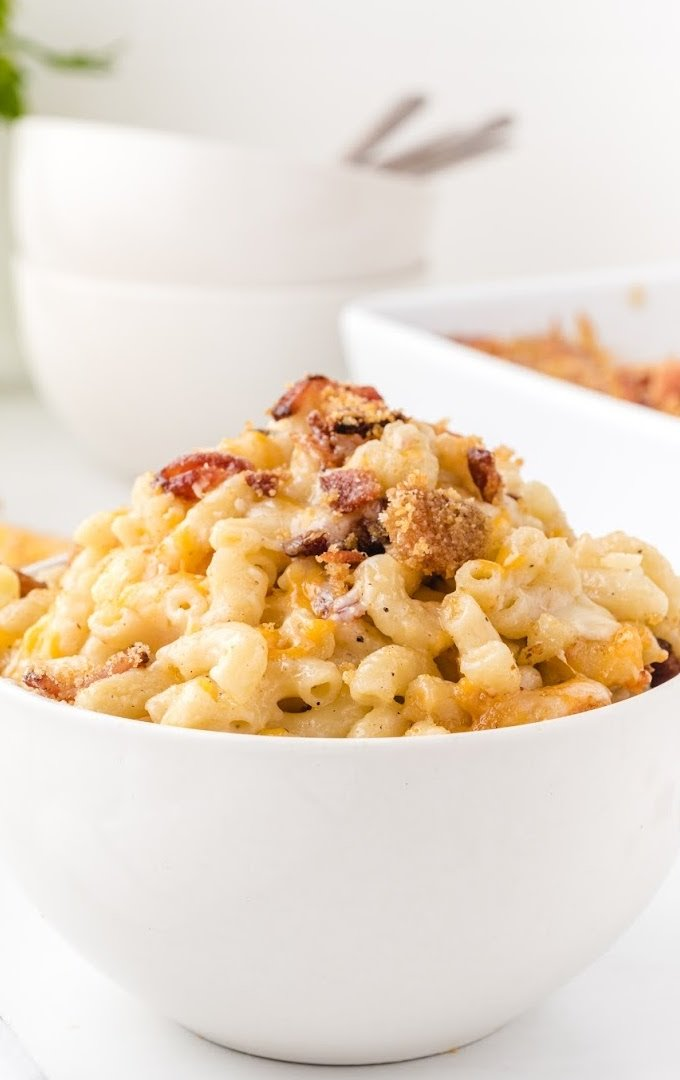 close up shot of bacon mac and cheese in a white bowl