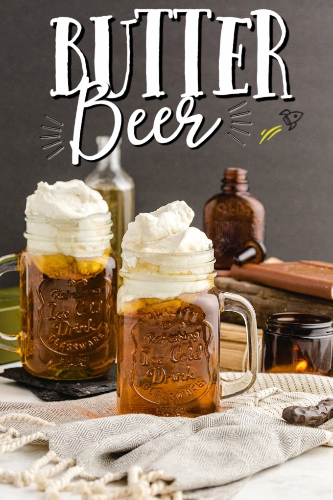 butterbeer in glass jugs with whipping on top
