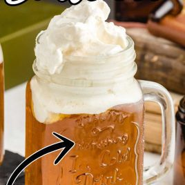 close up shot of a jug of Butterbeer topped with butter cream topping