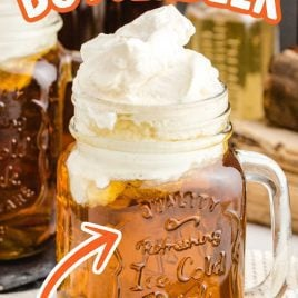 close up shot of jugs of Butterbeer topped with butter cream topping