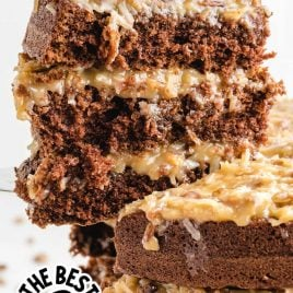 close up shot of a slice being taken out of German Chocolate Cake with coconut pecan frosting