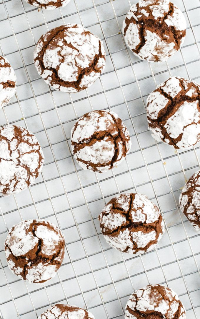 chocolate crinkle cookies lined up on a silver tray