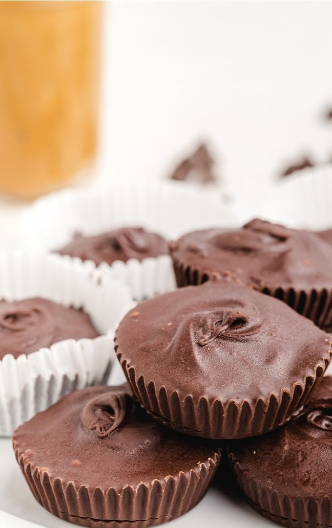 homemade peanut butter cups piled on top of each other